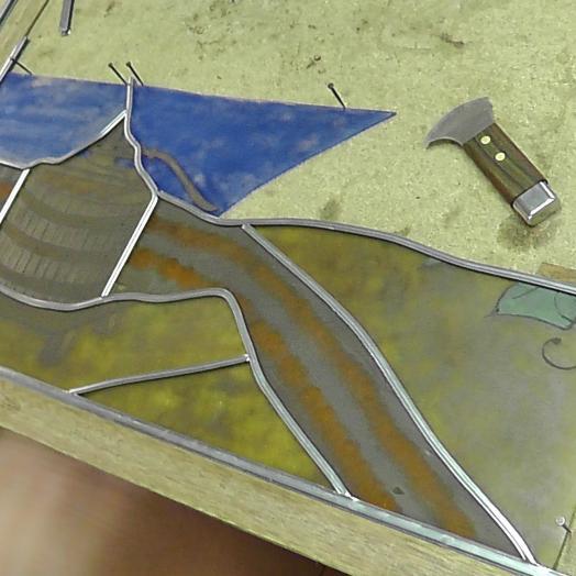Travail en cours de peinture sur verre